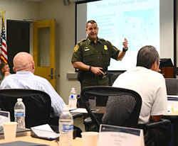 U.S. Border Patrol Chief Michael Fisher speaks to class of the Executive Leaders Program. (Photo courtesy of NPS.)