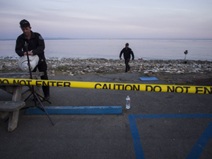 Workers clean a beach following the Refugio Oil Spill in Santa Barbara County. (Photo courtesy of CBS Los Angeles)